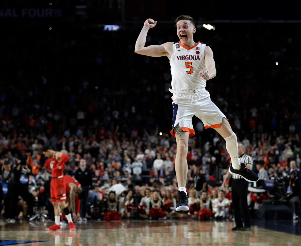 Virginia's Kyle Guy celebrates after the Cavaliers beat Texas Tech 85-77 in the overtime of the NCAA Division I men's basketball game Monday in Minneapolis.