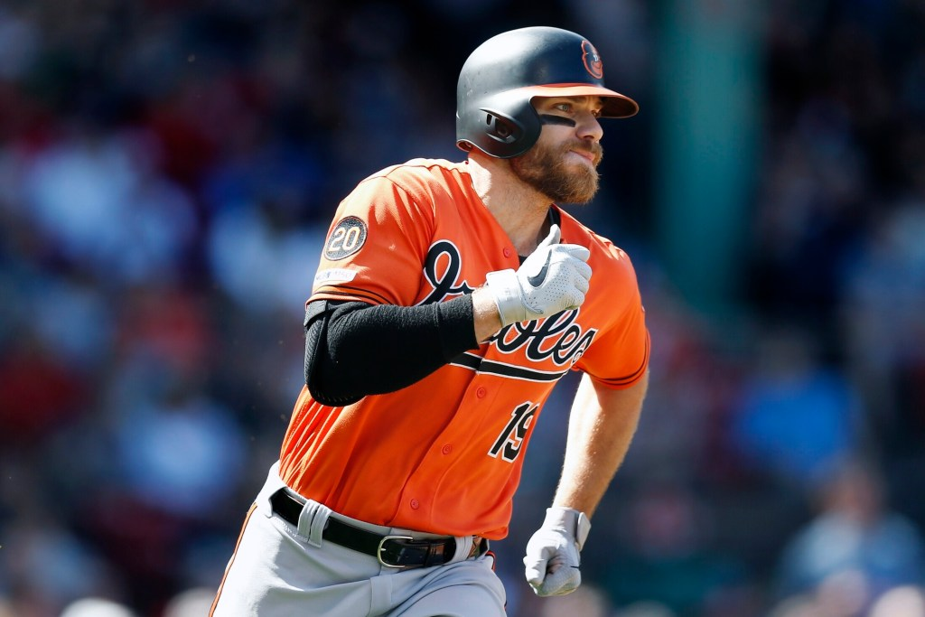 Chris Davis ended his 0 for 54 slump with a two-run single in the first inning, then added an RBI double as the Orioles beat the Red Sox 9-5 on Saturday in Boston.