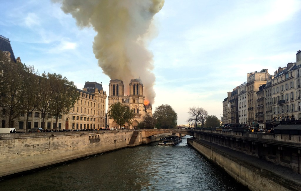French president vows to rebuild fire-ravaged Notre Dame