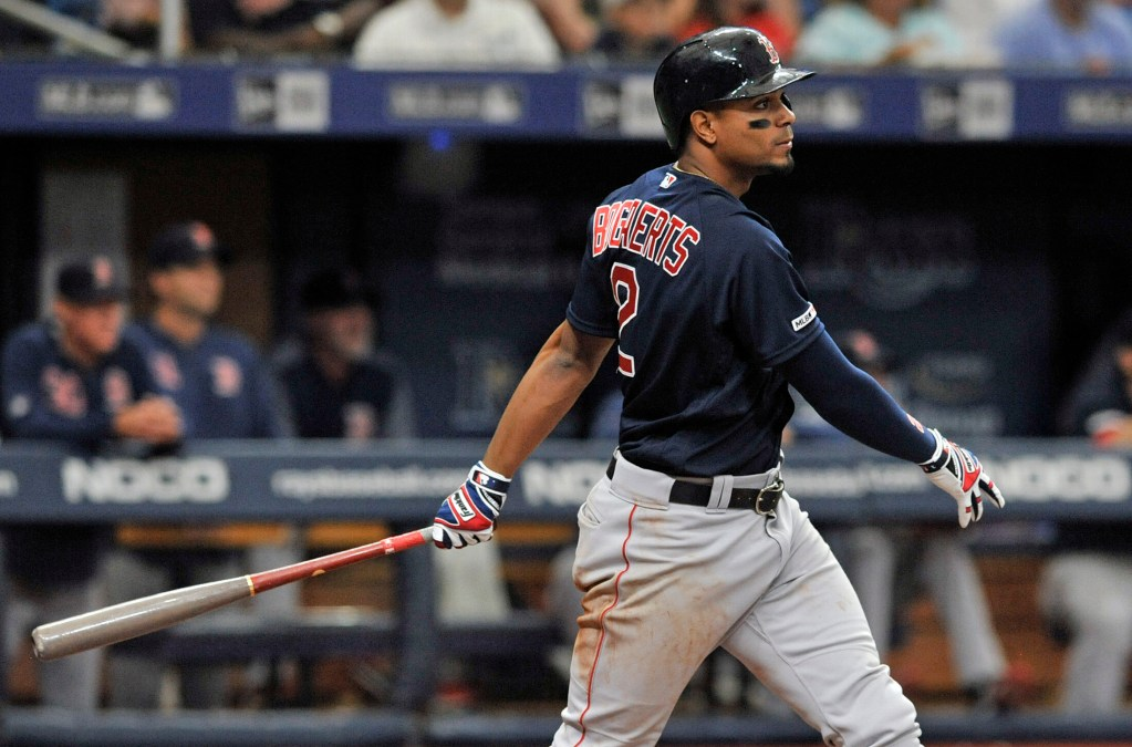 Xander Bogaerts hits a two-run double in the sixth inning for the Red Sox against Tampa Bay on Sunday in St. Petersburg, Florida.