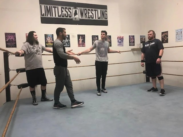 Dave Dyer, far right, listens with other students as Aiden Aggro, long sleeves, gives instruction at the Limitless Dojo in Brewer.
