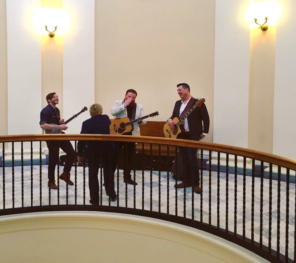 "Members of The Ghost of Paul Revere with Gov. Janet Mills (back to camera) April 3 at the State House. The band met with legislators in advance of its song, ""The Ballad of the 20th Maine,"" being proposed as the official state ballad."