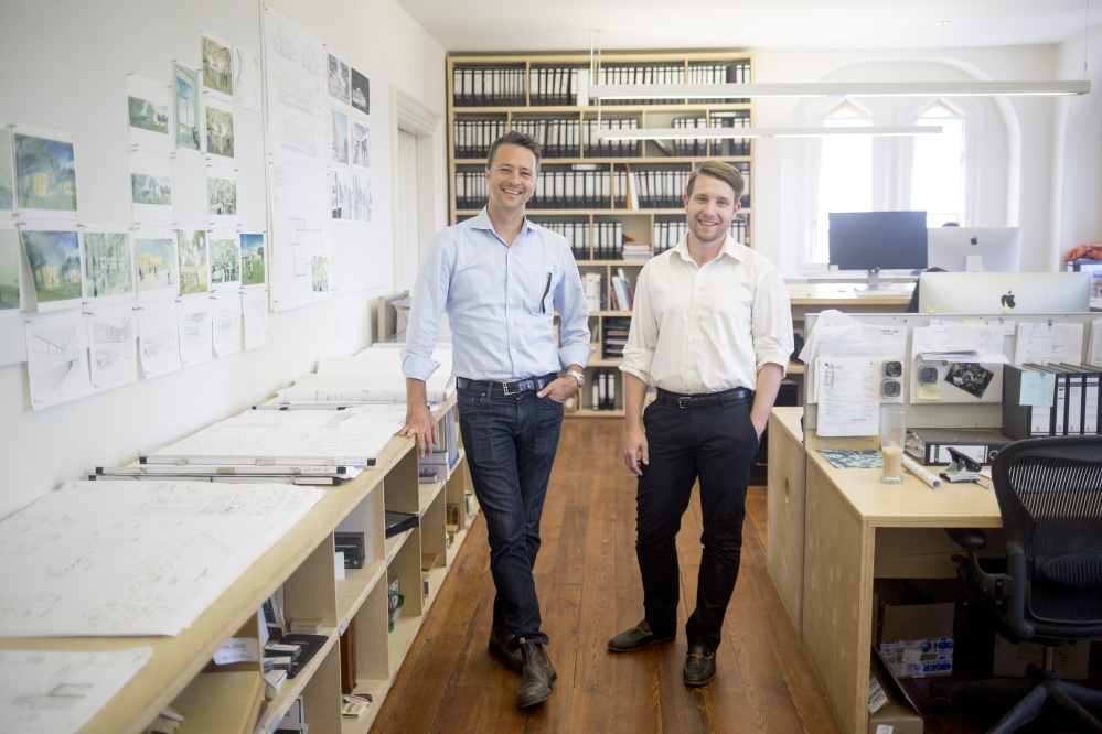 Matthew O'Malia, left, founder of GO Logic, and Joshua Henry, a partner in GO Lab, pose for a portrait in their Belfast office building in 2017. GO Logic is a high-performance home builder working to develop a wood-based insulation board. It launched GO Lab to spearhead research and development.