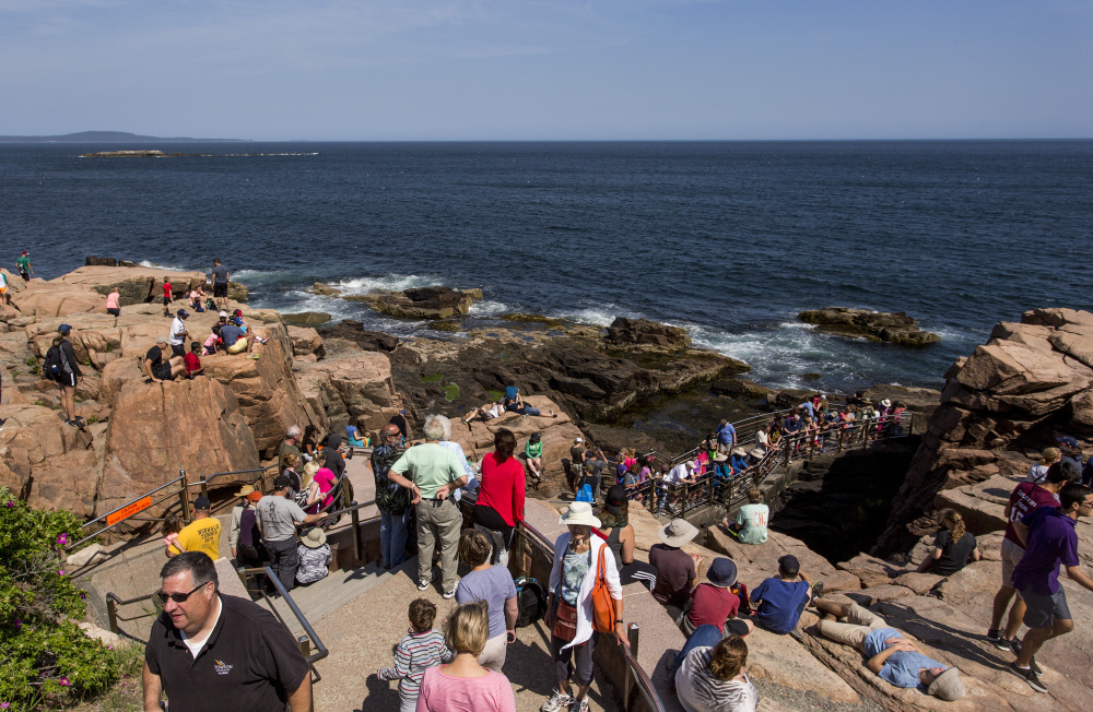 Tourists flock to Thunder Hole at Acadia National Park in June 2016. Maine hosted about 37 million tourists in 2018, a slight increase over the previous year.