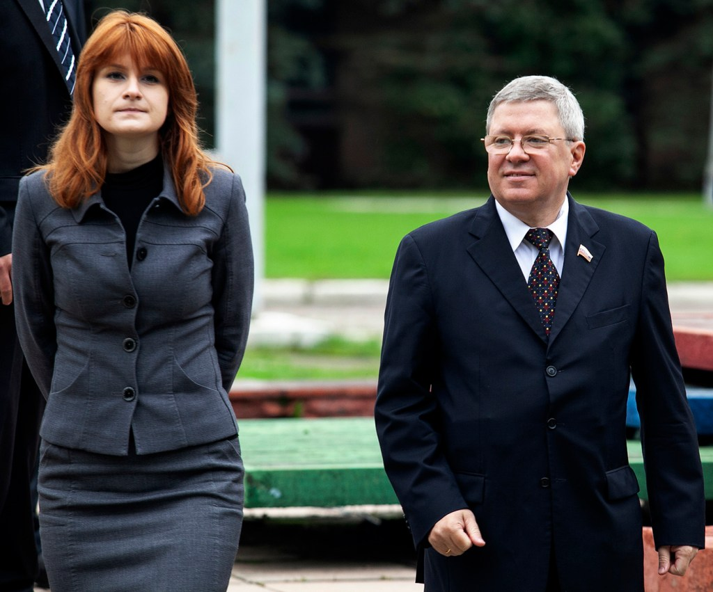 Maria Butina walks with Alexander Torshin then a member of the Russian upper house of parliament in Moscow in 2012.