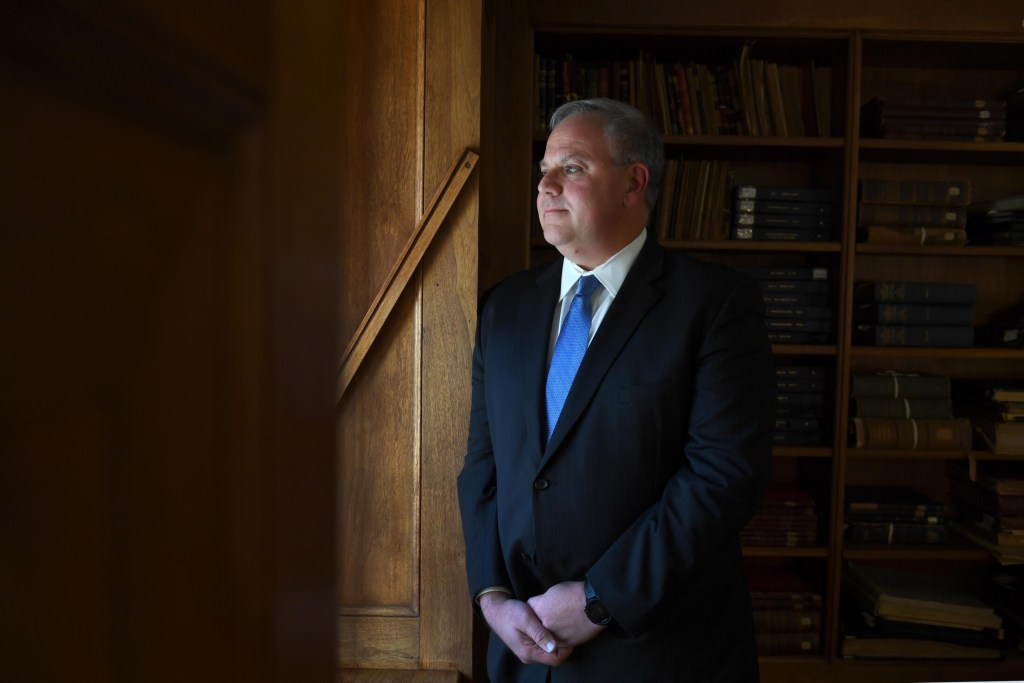 David Bernhardt, then-deputy secretary of the interior, is shown in the library at the Department of the Interior in October 2018 in Washington. The Senate confirmed Bernhardt's nomination to lead the department permanently Thursday.