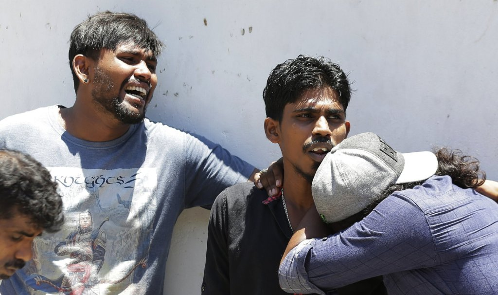 Relatives of people killed in church blasts in Sri Lanka mourn as they wait outside a mortuary in Colombo, Sri Lanka on Sunday. Near-simultaneous blasts rocked three churches and three hotels in Sri Lanka on Easter Sunday.