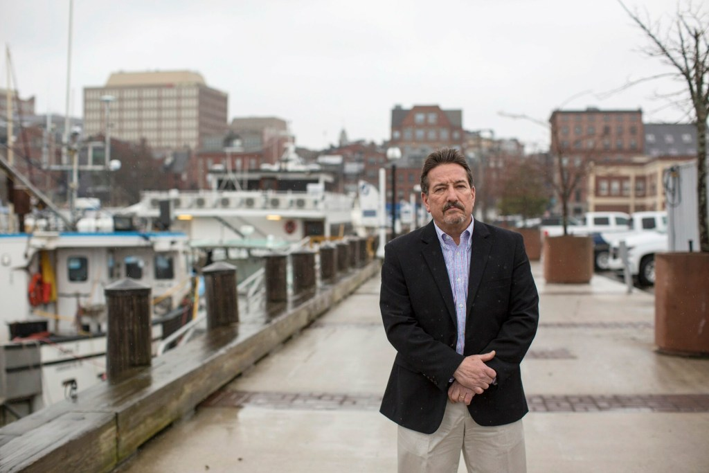 Steve DiMillo poses for a portrait on Long Wharf in Portland. He and two other pier owners sent the city a letter expressing concerns that proposed zoning changes on the waterfront could needlessly restrict future development on their properties.