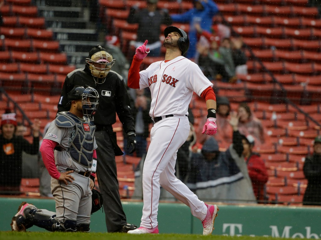 J.D. Martinez, right, celebrates his two-run home run in the eighth inning of Boston's 11-2 win over Seattle on Sunday in Boston. Martinez homered twice Sunday.