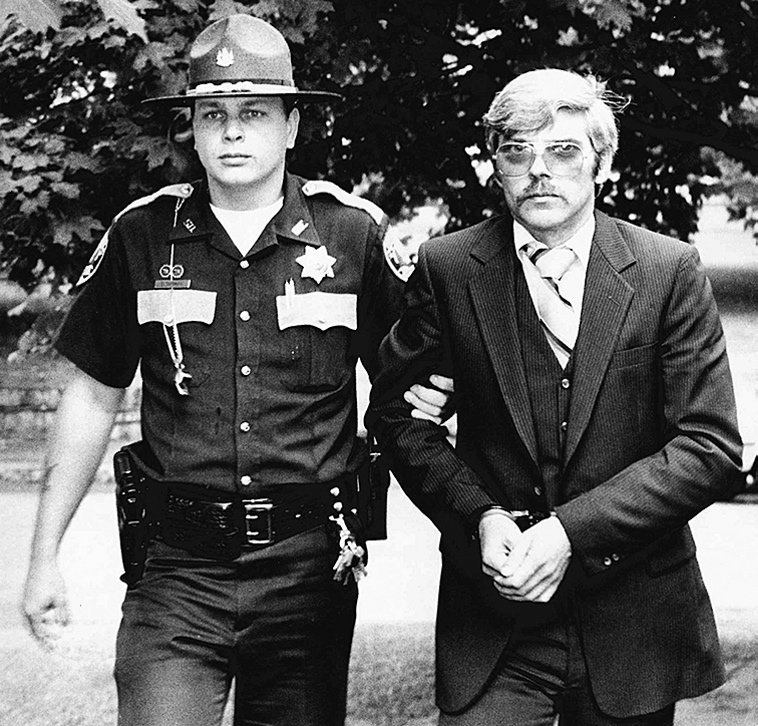 Michael Boucher, right, is escorted by Kennebec County Deputy Eric Testerman on July 9, 1991.