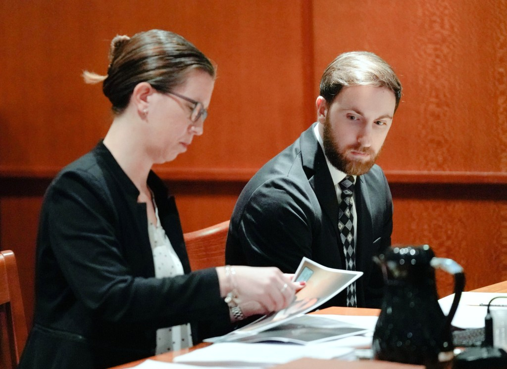 Mark Cardilli Jr. looks as Sarah Churchill, one of his attorneys, gathers photos during his bail hearing at the Cumberland County Courthouse on Tuesday.