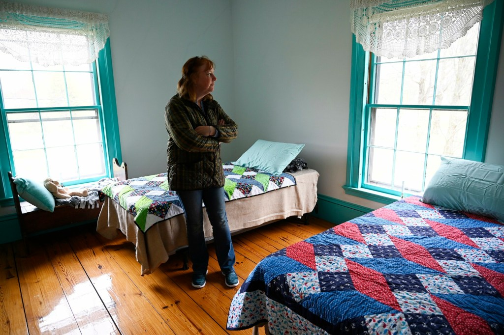 Susan Austin, the assistant superintendent for SAD 60, shows a bedroom of the Ryan Home, which she helped create to provide a home to some of the rising number of homeless students in the Berwick area.