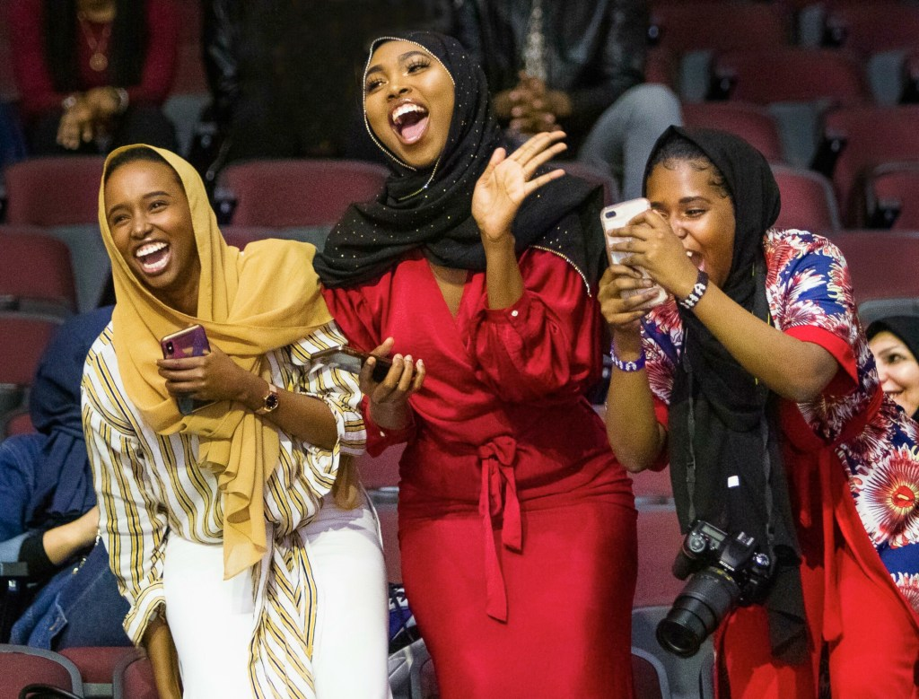 PORTLAND, ME - MAY 12: Sisters Hamdi Sheikh, Fardowsa Mohamed,and Aisha Mukhtar cheer for their sister Maryan Mukhtar who had just received a degree in Liberal Studies during the Southern Maine Community College commencement at Cross Insurance Arena in Portland on Sunday, May 12, 2019.(Staff Photo by Carl D. Walsh/Staff Photographer)