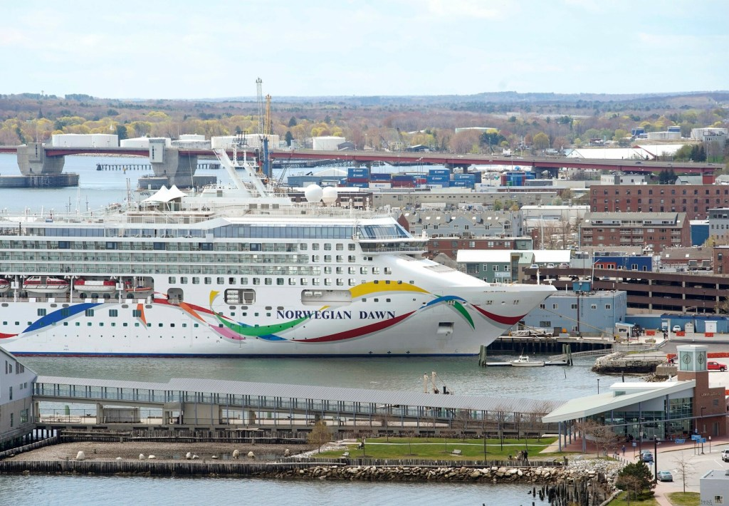 The Norwegian Dawn is moored in Portland Harbor earlier this year. A state report released Thursday says most cruise ship passengers like Maine ports and spend about $70 each while on a typical four-hour visit.