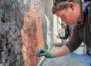 PHOTO: Artists install murals at Hartley Block in Lewiston