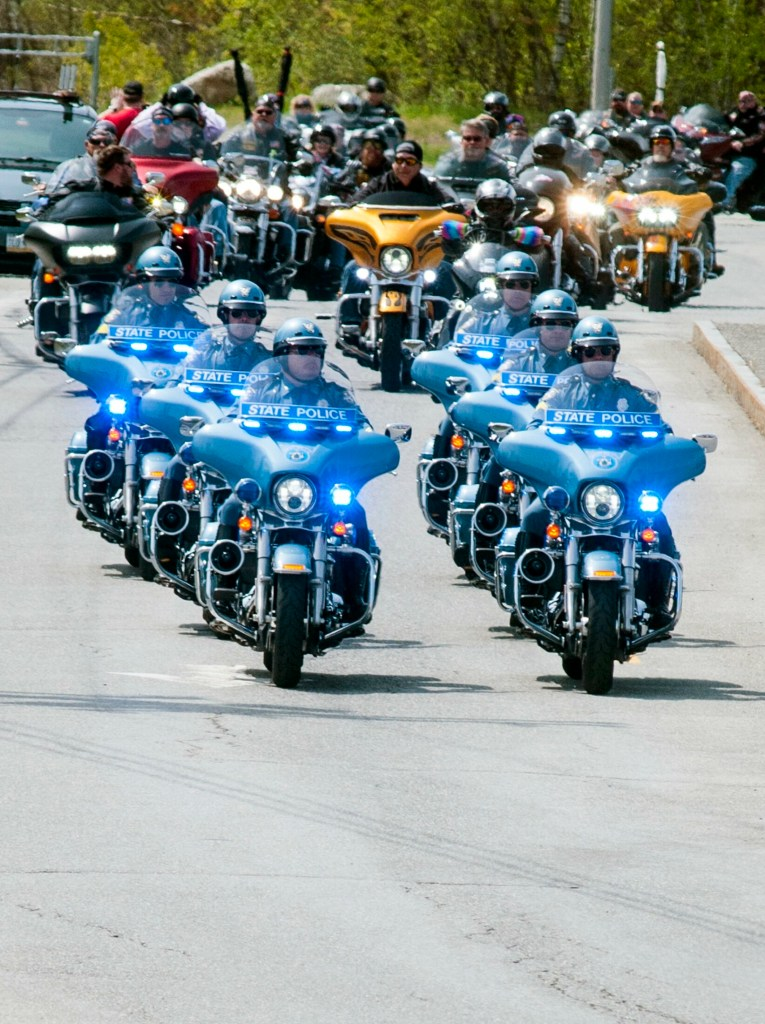 State police troopers on motorcycles lead The Summit Project convoy on Saturday as the group leaves the West Gardiner service plaza on the Maine Turnpike.