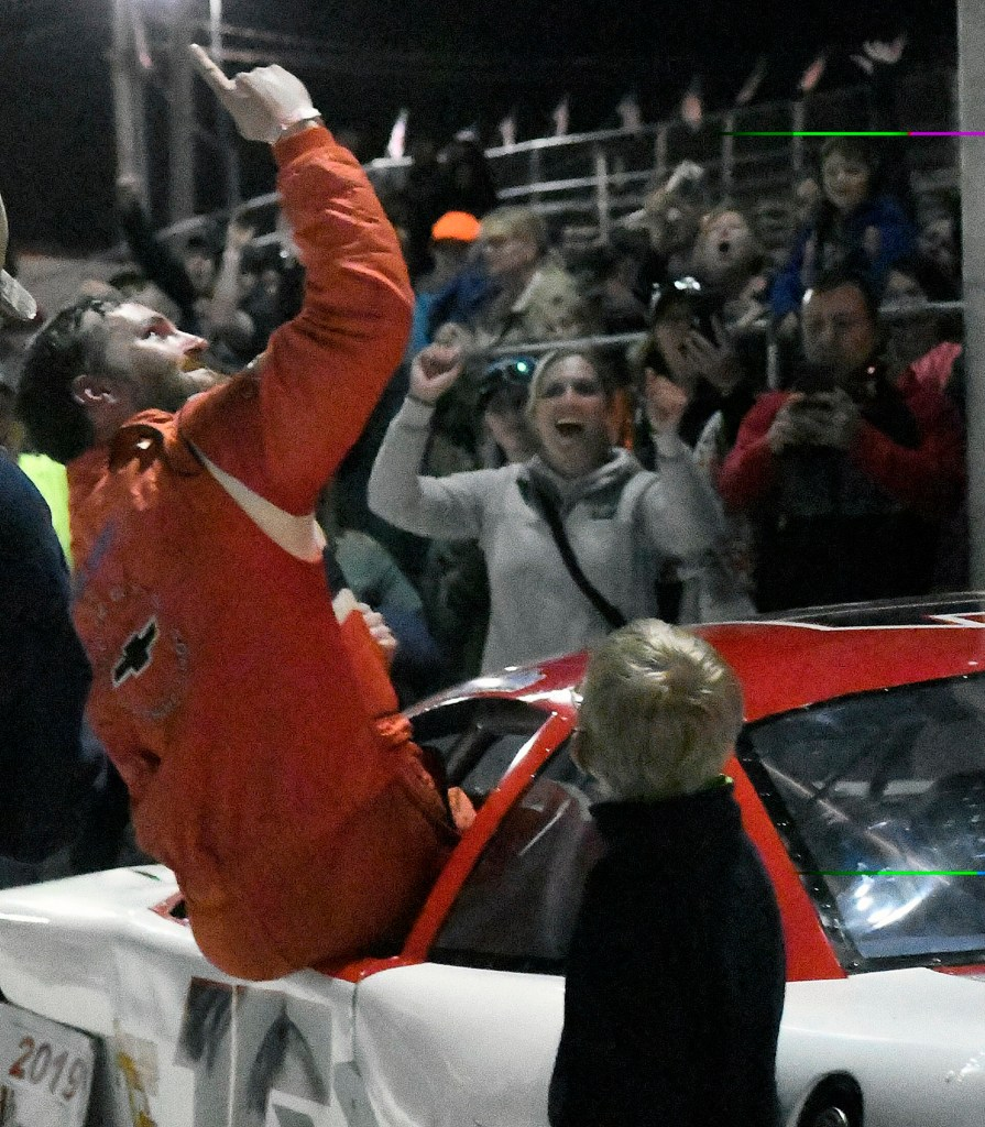 Ben Ashline celebrates after winning the Coastal 200 on Sunday at the Wiscasset Speedway.
