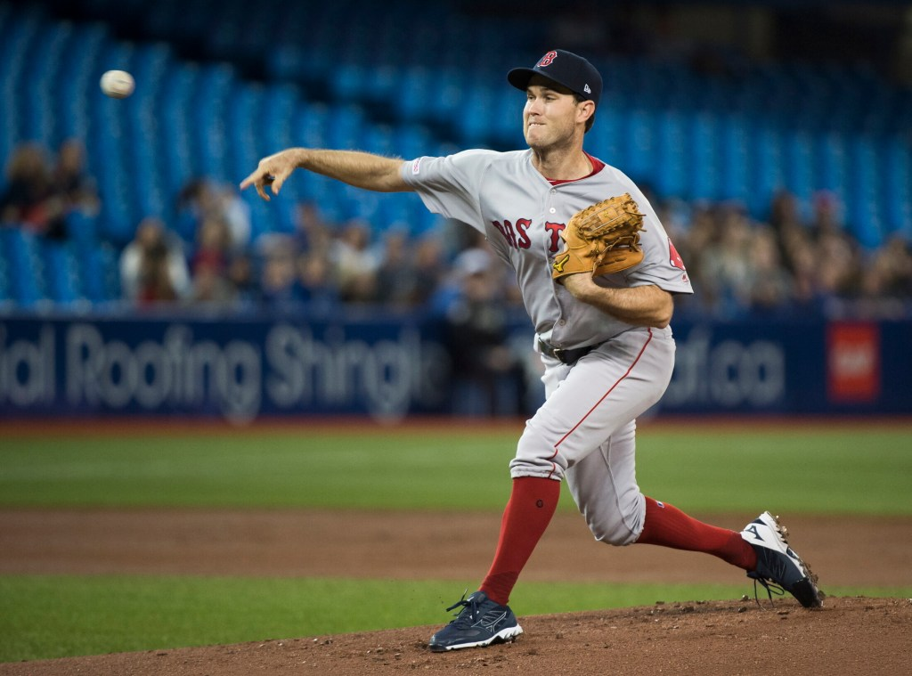 Boston Red Sox starting pitcher pitcher Ryan Weber works against the Toronto Blue Jays Thursday in Toronto.