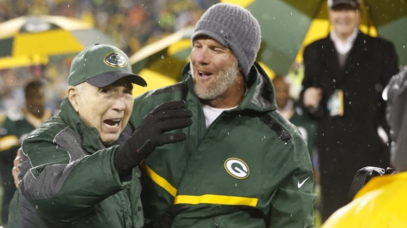Brett Favre smiles with Bart Starr during a ceremony at halftime of a 2015 game at Lambeau Field. Favre's retired No. 4 and name were unveiled. Starr died Sunday at the age of 85.