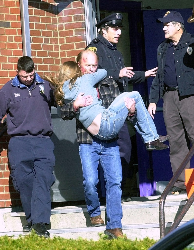 """Actor Ed Harris carries a girl out of Waterville High School, where a shooting scene in the """"Empire Falls"""" movie was filmed in 2003. Behind Harris is actor William Fichtner, who played a police officer in the 2005 TV movie miniseries filmed throughout central Maine. Harris has pledged $75,000 for the future Paul J. Schupf Art Center being planned for 93 Main St. in downtown Waterville."""