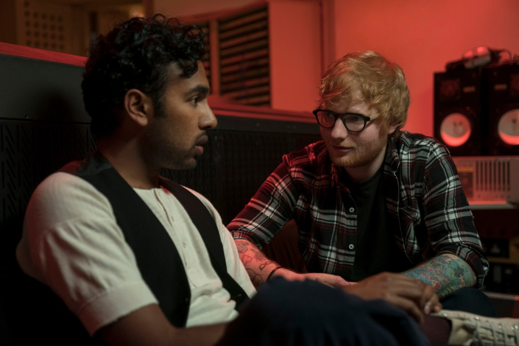 "This image released by Universal Pictures shows Himesh Patel, left, and Ed Sheeran in a scene from ""Yesterday."""