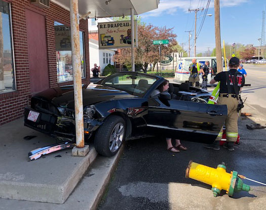 A 1989 mail truck collided with a 2013 Mustang convertible at the intersection of Getchell Street and College Avenue on Monday afternoon. Alexia Dumont, 18, of Albion, lost control of the car, which took out a fire hydrant and bumped up the concrete steps of R.E. Drapeau, a furniture and appliance store. No one was injured in the accident.