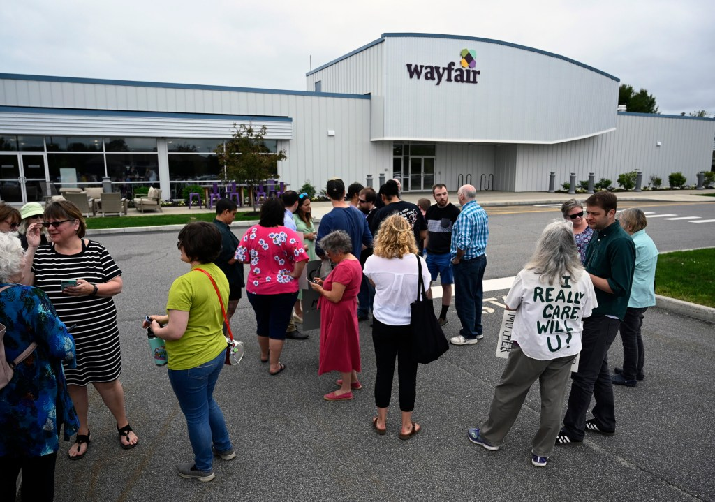 Employees, supporters and journalists gather outside Wayfair in Brunswick as workers walked out Wednesday to protest sales of furniture to a contractor that operates migrant detention centers on the southern border.
