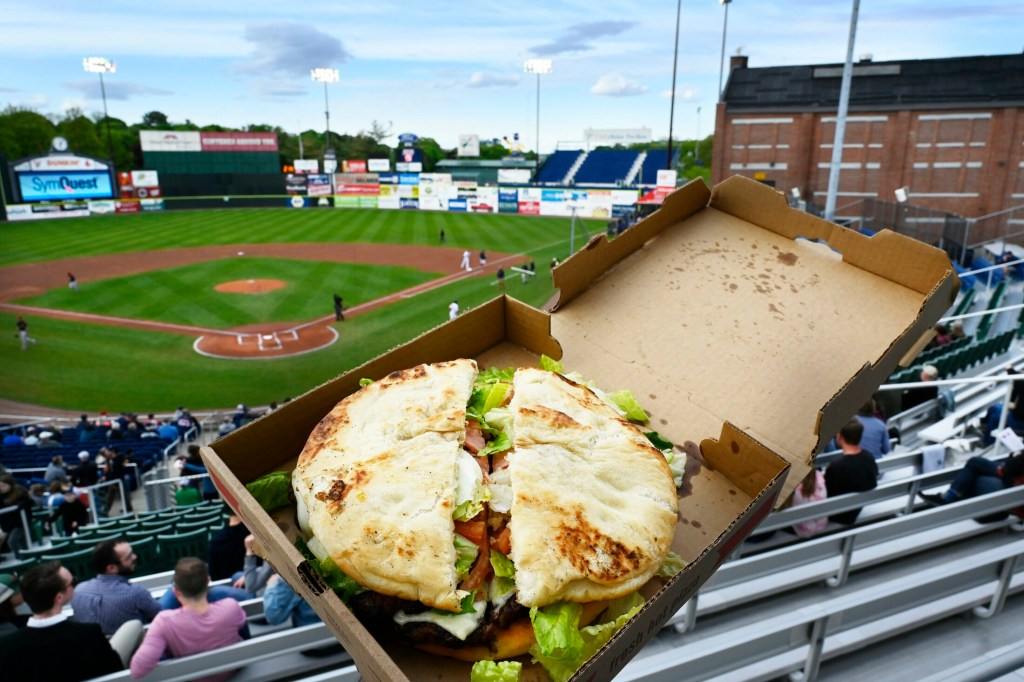 The new Fried Dough Burger at Hadlock Field: two frybreads, eight hamburger patties, bacon, cheese, lettuce and tomato. We hope you're hungry.
