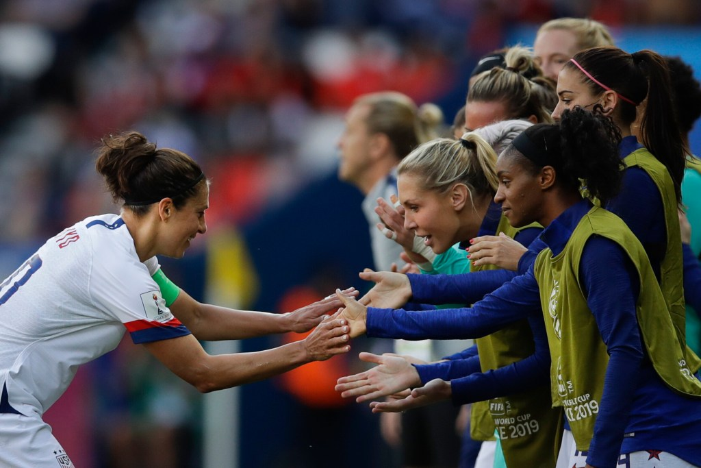Carli Lloyd, left, celebrates with teammates after scoring the first goal is the U.S. women's soccer team's victory over Chile on Saturday in Paris, France.