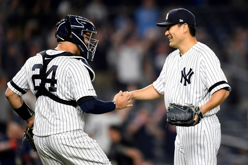 Yankees starter Masahiro Tanaka, right, celebrates with catcher Gary Sanchez after pitching a shutout in New York's 3-0 win over Tampa Bay on Monday in New York.