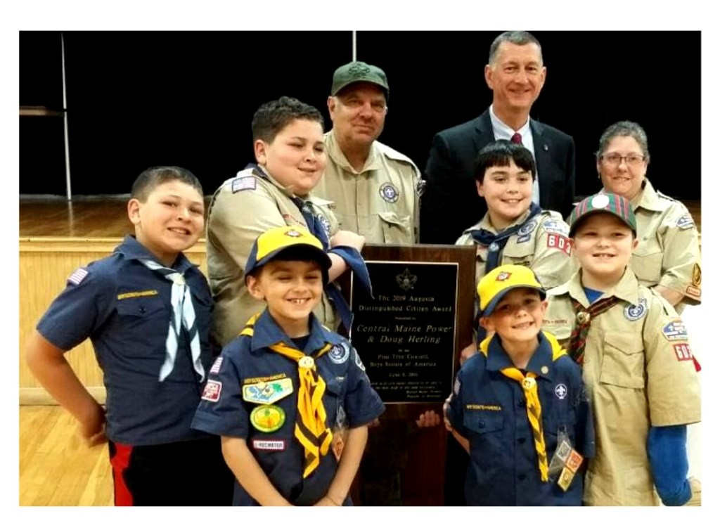 Pine Tree Council Scouts of America presented its 2019 Distinguished Citizen Award to Central Maine Power Co. In front from left, are Jaxon Boyd, Tristan Morton, Cooper Selwood and Jeffrey Mason. In back, from left, are Isaac Boyd, Douglas Mason, CMP CEO Doug Herling, Anthony Fortin and Michelle Selwood. The Scouts represent Scout Troop 603 and Cub Pack 603.
