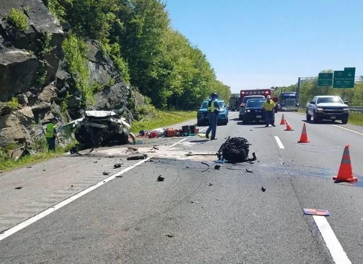 Police say this car crashed into the stone ledge along the northbound lanes of Interstate 295 in Falmouth and the impact ripped the engine from the vehicle's frame.