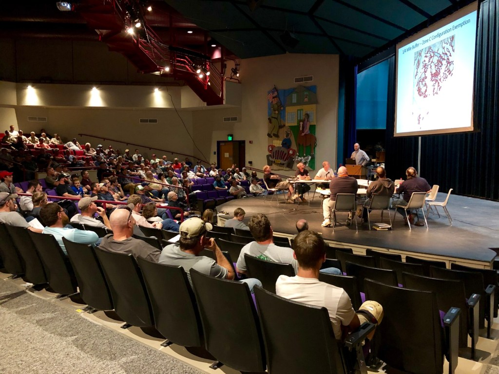 Carl Wilson, director of the marine science bureau of the Maine Department of Marine Resources, tells a group of 150 lobstermen about proposed whale protection rules in Deer Isle Thursday night. This part of the coast is the state's most lucrative lobster fishery, landing $116.5 million worth in 2018.