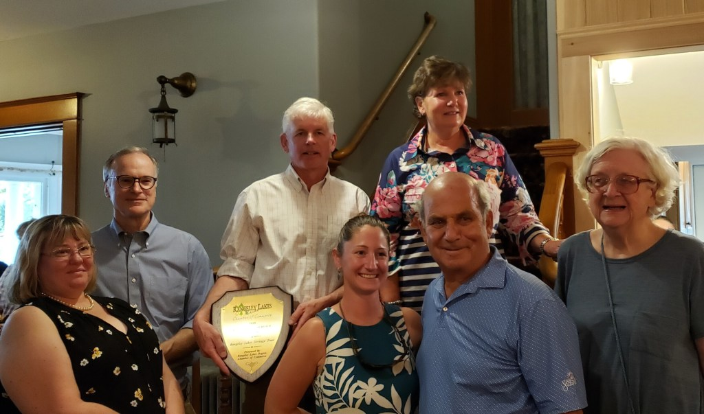 Rangeley Lakes Chamber of Commerce presented its annual Community Service Award to the Rangeley Lakes Heritage Trust. Front from left are Tracie Clinch, Amanda Laliberte and Ed Kfoury, of the trust; and Joanne Dunlap, chamber. Back from left are Bob Landis and David Miller, both with the trust; and Margie Jamison, chamber.