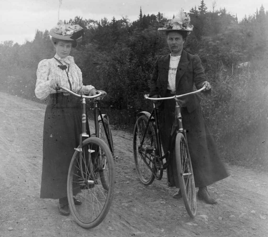 Two women and bikes.