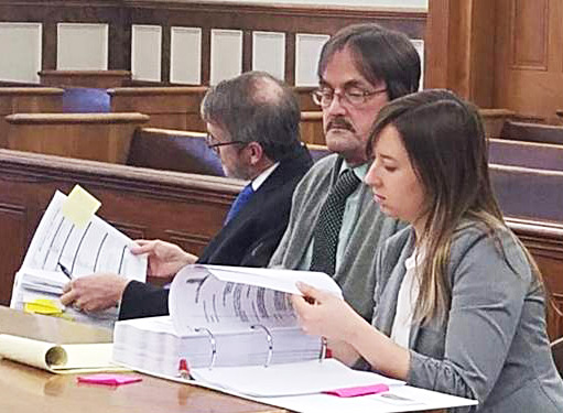 Randall Weddle, center, sitting with his attorneys during his trial, was convicted of   his t, Christopher MacLean and Laura Shaw, in Knox County Superior Court in 2018.