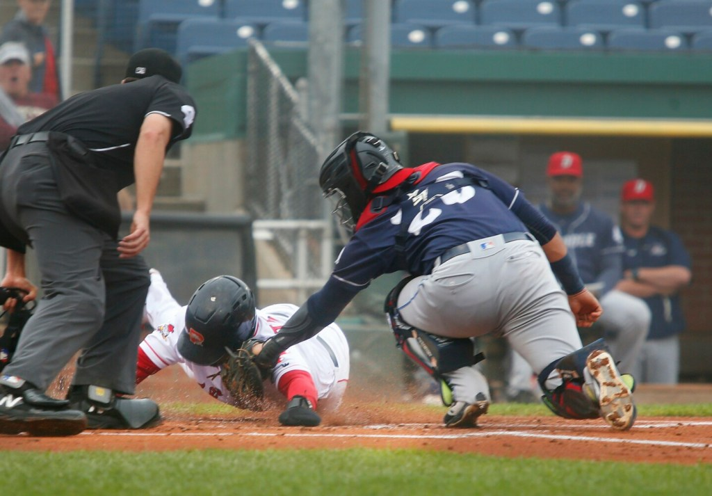 Luke Tendler of Sea Dogs is tagged out at home by Ali Sanchez of Binghamton while trying to score on a two-out hit by Joey Curletta in the first inning of the first game Thursday night. Binghamton won 3-2.