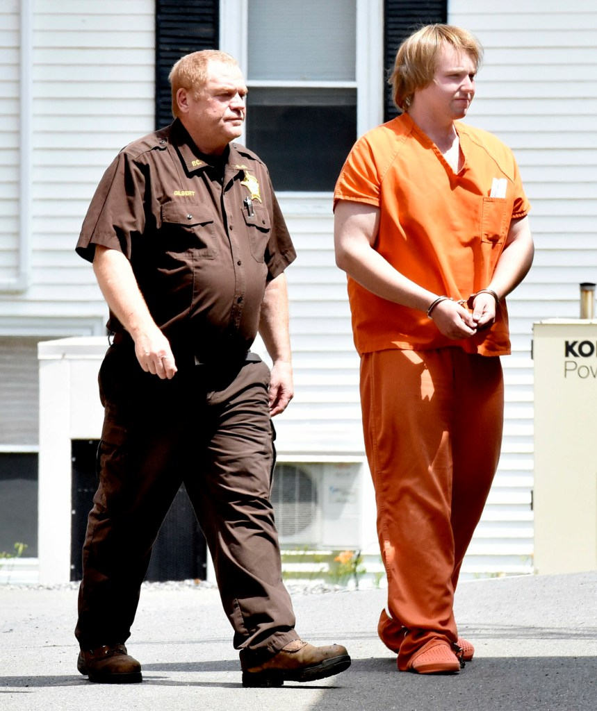 Christopher Hallowell, right, is led by a sheriff's deputy Tuesday into the Piscatquis County Jail in Dover-Foxcroft after a hearing on charges including aggravated attempted murder after his arrest Monday morning in Albion.