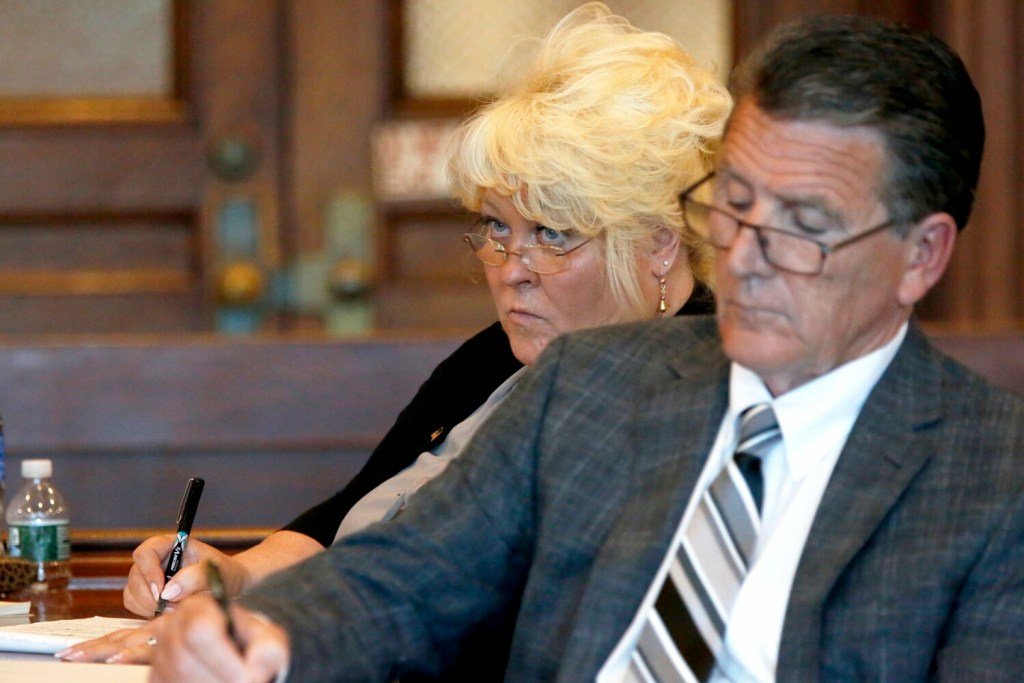 Annemarie Germain listens to opening arguments with her attorney Gene Libby on July 15 at the Cumberland County Courthouse. The Portland Museum of Art sued Germain, saying she manipulated a wealthy benefactor to remove a large donation from her will.