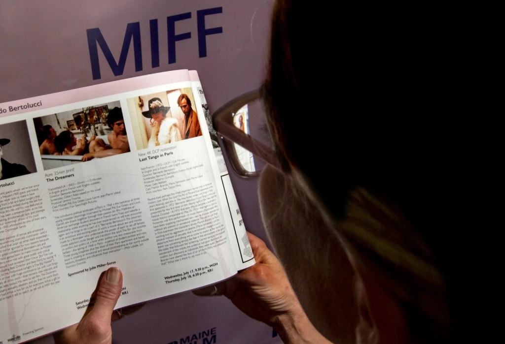"""Michele Sweet reads the program Tuesday for the 22nd Maine International Film Festival, which is showing """"Last Tango in Paris"""" Wednesday night at the Waterville Opera House."""