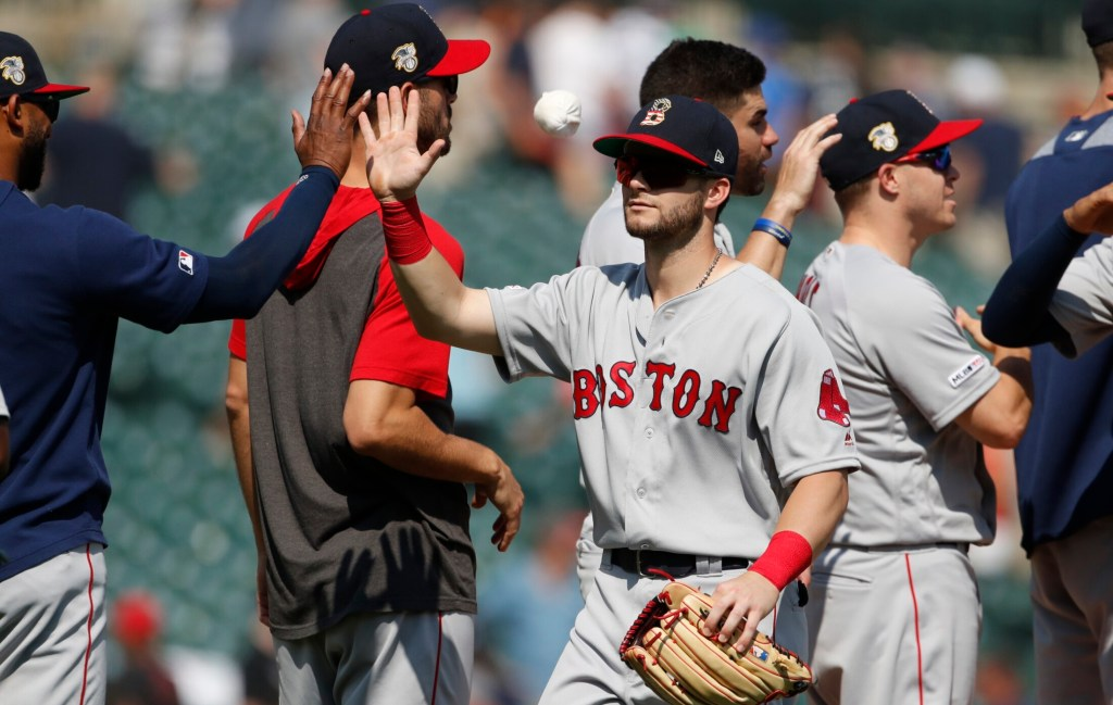 Andrew Benintendi and the Red Sox celebrate after beating the Detroit Tigers for their fifth win in six games on Sunday. Boston gained some momentum heading into the All-Star break, sweeping the Tigers.