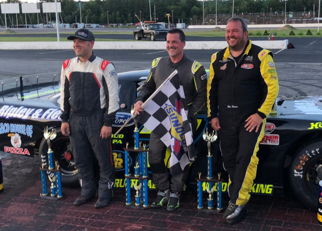 Nick Sweet, left, Curtis Gerry, center, and Ben Rowe stand in victory lane following Gerry's win in the PASS 150 at Oxford Plains Speedway in Oxford in July.