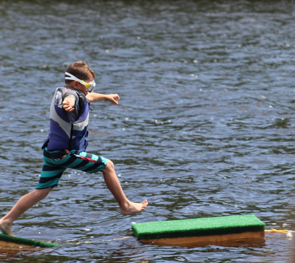 Baylor Hutchings, 6, takes a leap of faith onto a lobster trap during Richmond Days on Saturday.