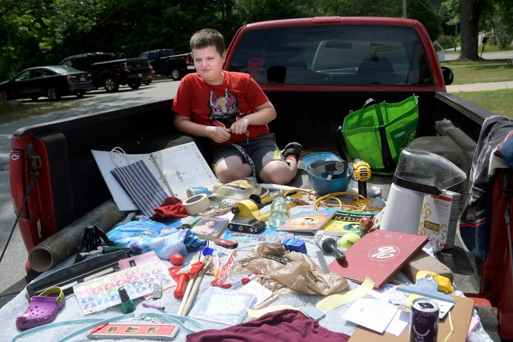 Casper Hooper, 9, waits for a judge to check the collection of items he and his family gathered in the bed of their truck Sunday during the 16th annual China Community Days scavenger hunt.