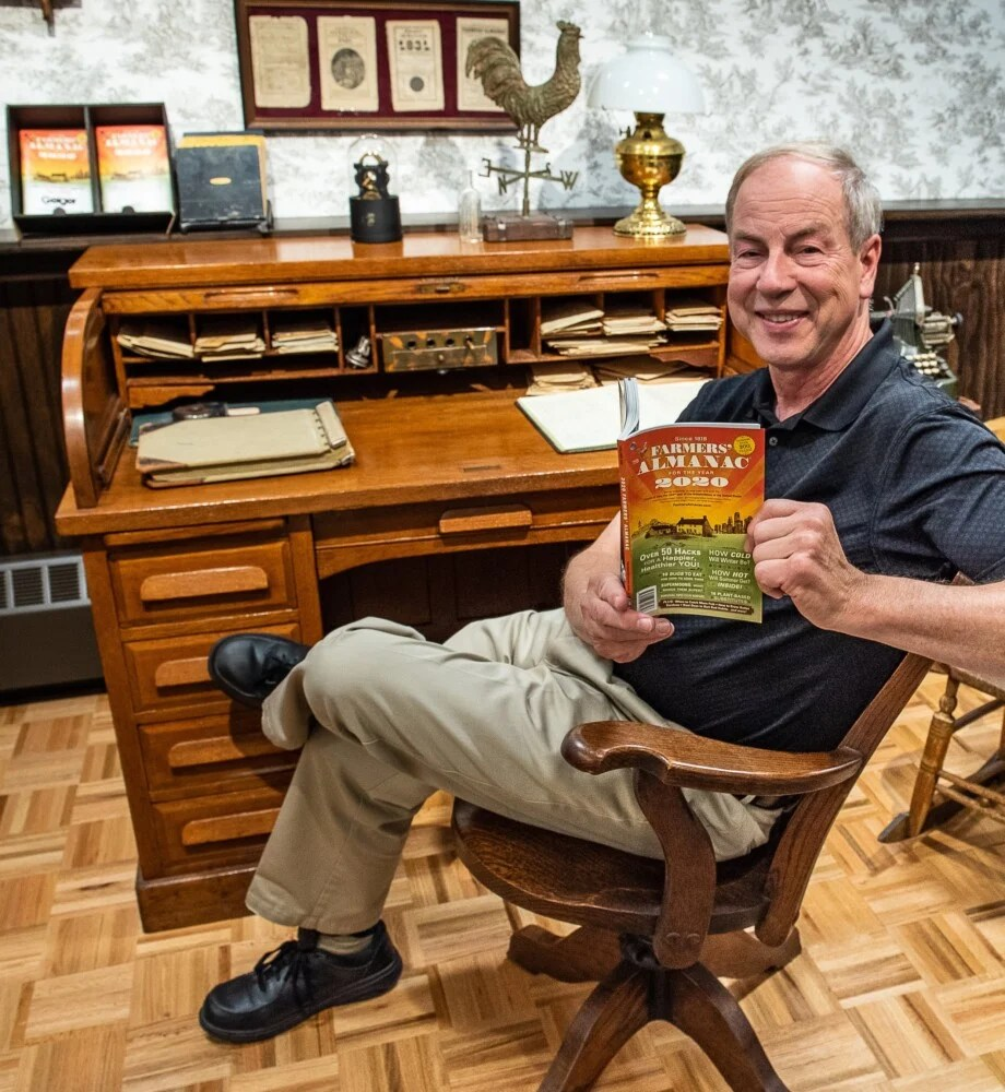 Farmers' Almanac editor Peter Geiger holds the latest edition at Geiger in Lewiston on Wednesday afternoon.