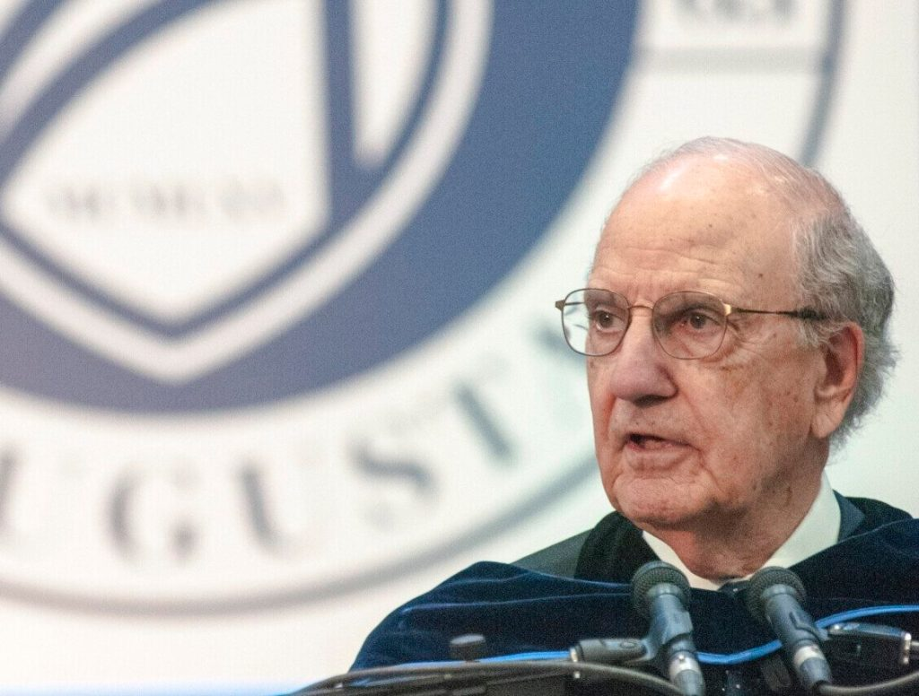 George Mitchell gives the commencement address during the University of Maine at Augusta graduation on May 12, 2018, at the Augusta Civic Center.