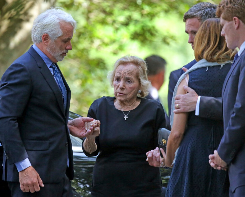 Ethel Kennedy is helped to the church during funeral services for her granddaughter Saoirse Roisin Kennedy Hill at Our Lady of Victory Church in Centerville, Mass., on Monday.