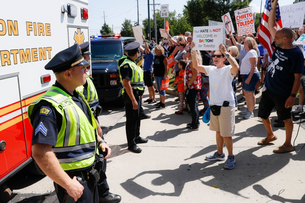 Demonstrators chant as they protest the arrival of President Trump on Wednesday outside Miami Valley Hospital after a mass shooting that occurred Sunday in Dayton, Ohio.