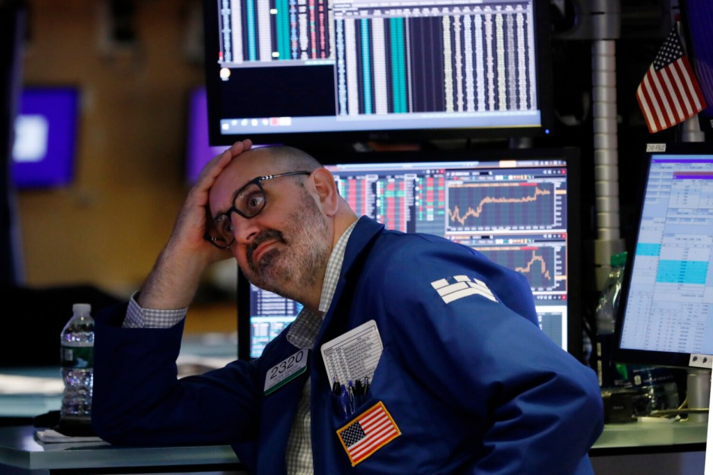 """Specialist Peter Giacchi works on the floor of the New York Stock Exchange on Friday, when stocks tumbled after President Trump said he """"hereby ordered"""" U.S. companies to consider alternatives to doing business in China."""