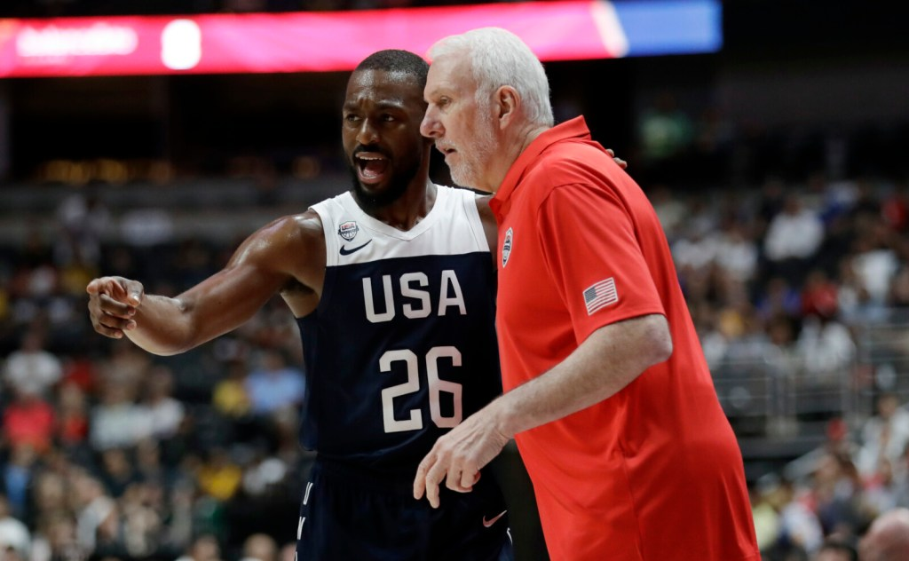 Kemba Walker, left, talks to  Coach Gregg Popovich during the first half of Team USA's 90-81 win over Spain in an exhibition game Friday in Anaheim, California.